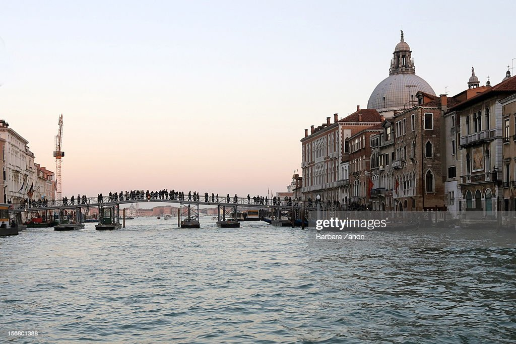 A general view of the Votive Bridge on Gran Canal that connects Saint Mark to the Santa Maria Della Salute Church during the Santa Maria Della Salute celebrations on November 21, 2012 in Venice, Italy. During the annual Santa Maria Della Salute celebrations, Venetians make pilgrimage to the Church to give thanks to the Virgin Mary (Maria), who is believed to have brought an end to the plague which struck the city in 1629.