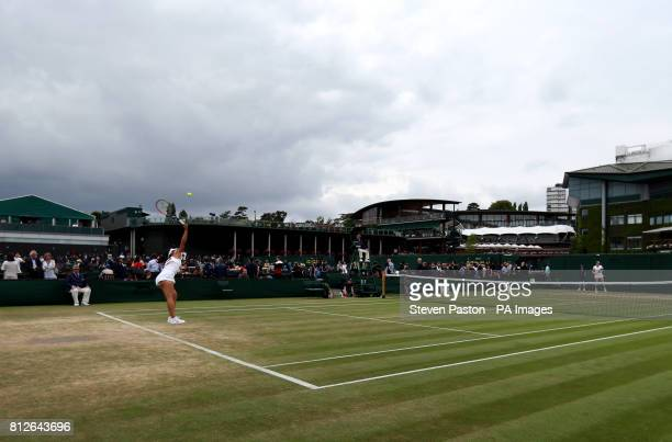 General view of the wear and tear to the grass on the baseline of court ten as Mai Hontama serves on day eight of the Wimbledon Championships at The...