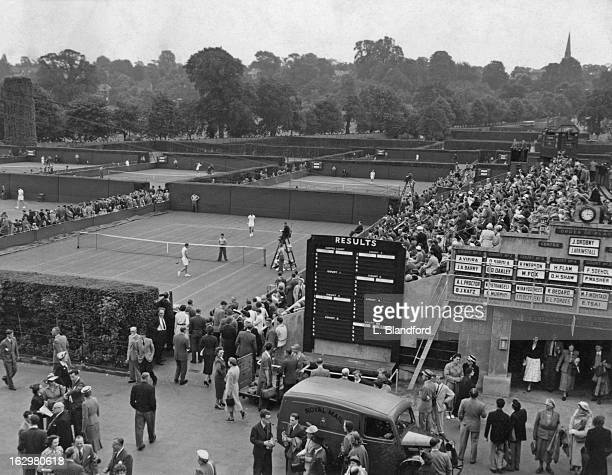 A general view of the Wimbledon Lawn Tennis Championships London UK 22nd June 1954 In the foreground Australia's Roy Emerson takes on M Fox of the US...