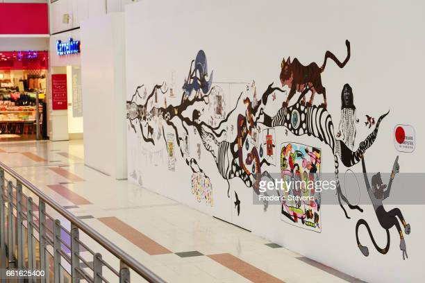 A general view of the work of France streetartist Renaud Delorme displayed in the commercial center of Bercy 2 near for the Street Art Anamorphose...