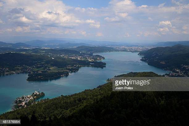 General view of the Worthersee lake with the towns of Poertschach and Klagenfurt in the Carinthia region ahead of the 2014 Ironman Austria on June 28...