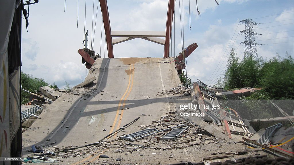 A general view of The Wuyishan Gongguan Bridge after it collapsed on July 14, 2011 in Wuyishan, Fujian province of China. One person was killed and 22 injured after a bus plunged from the collapsed Wuyishan Gongguan Bridge. The cause of the Bridge collapse is not as yet known.