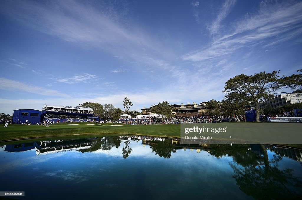 A general view of <a gi-track='captionPersonalityLinkClicked' href=/galleries/search?phrase=Tiger+Woods&family=editorial&specificpeople=157537 ng-click='$event.stopPropagation()'>Tiger Woods</a> and Ricky Fowler finishing up their day on the 18th hole during the first round at the Farmers Insurance Open at Torrey Pines Golf Course on January 24, 2013 in La Jolla, California.