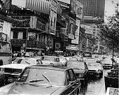 A general view of Times Square clogged with traffic on the streets and billboards on the buildings New York New York 1977 The Forum Theater is...