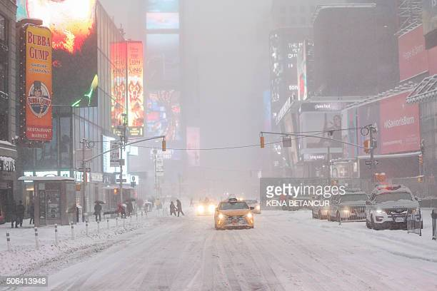 TOPSHOT A general View of Times Square while snow falls on January 23 2016 in New York A deadly blizzard with bonechilling winds and potentially...