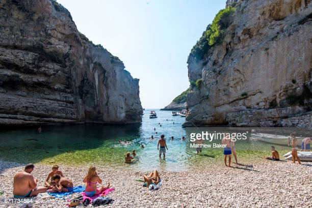 A general view of tourists swimming and sunbathing on Stiniva beach on September 2 2016 in Vis Croatia