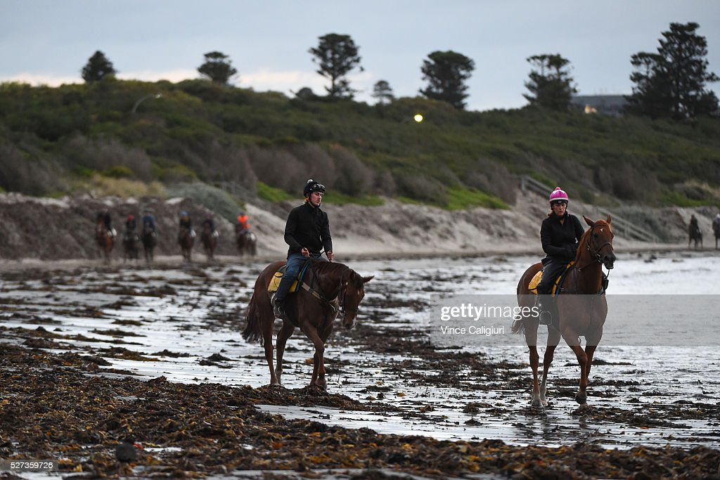 General view of trackwork session at Lady Bay beach ahead of the Warrnambool Racing Carnival on May 03, 2016 in Warrnambool, Victoria. Riders gallop the horses up and down the foreshore before cooling the horses in the ocean.