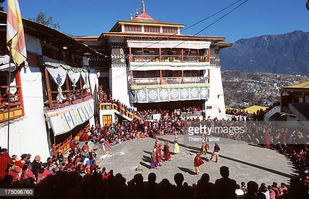 General view of traditional dances performed by monks dressed in ritual cloth and masks during the Torgya festival at the Tawang monastery