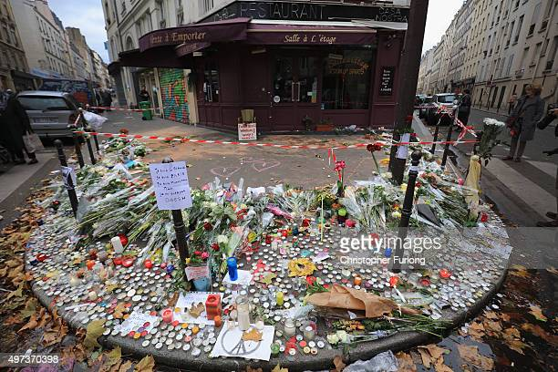 A general view of tributes outside the Casa Nostra Cafe one of the scenes of last friday's terror attacks on November 16 2015 in Paris France...