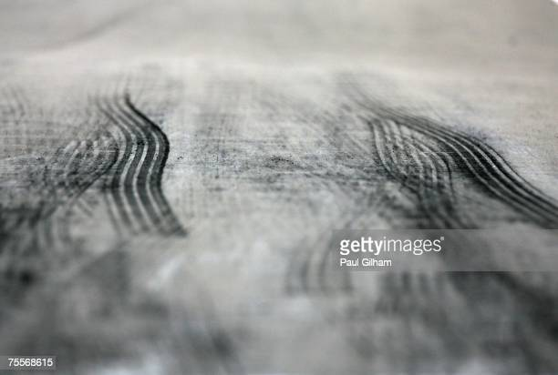 A general view of tyre marks left in the pitlane by Formula 1 cars as they exit their garages during practice for the European Grand Prix at...