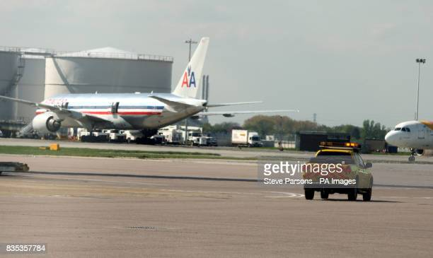 General view of vehicles and jets on the tarmac at Heathrow Airport Middlesex