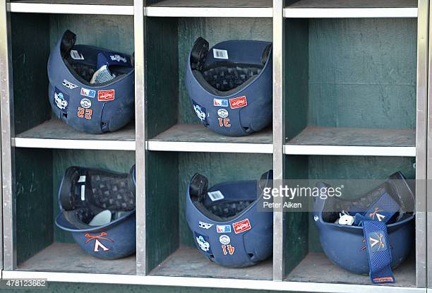 A general view of Virginia batting helmets at TD Ameritrade Park before game one of the College World Series Championship Series between the...