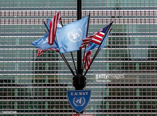 A general view of waving UN and US national flags outside the Secretariat Building at the United Nations Headquarters on September 22 2012 in New...
