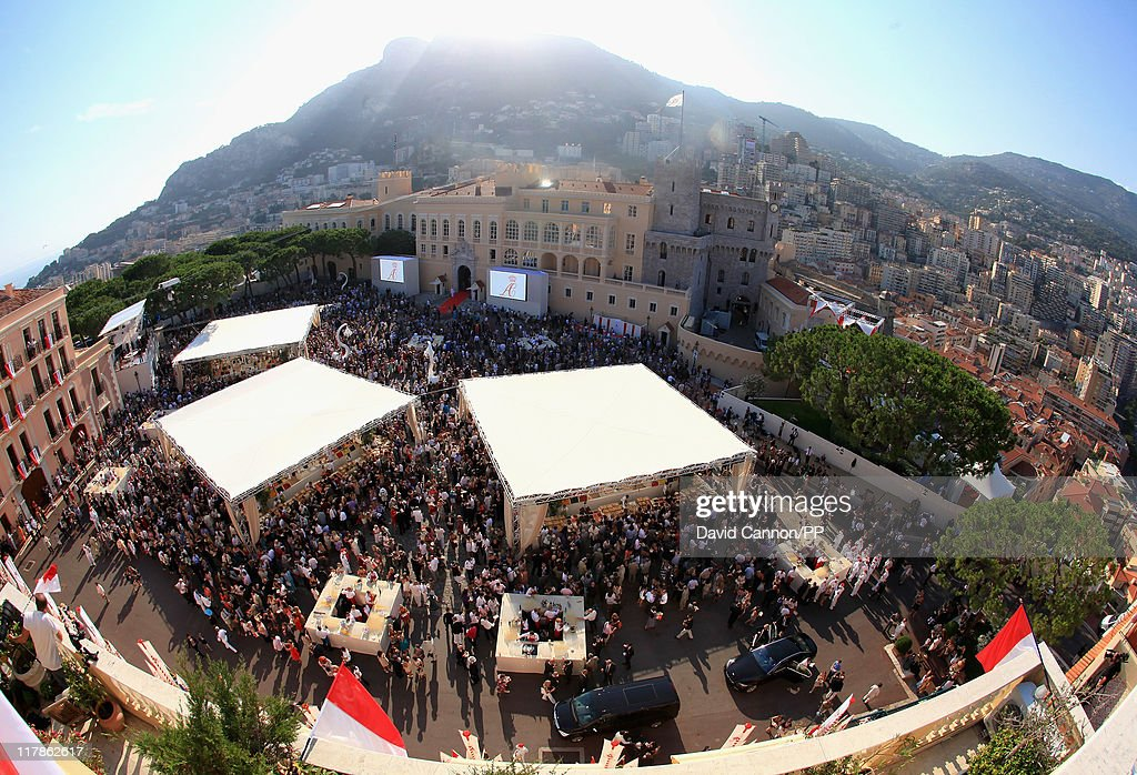 THIS IMAGE WAS CREATED WITH A FISH EYE LENS) A general view of well wishers outside the civil ceremony of the Royal Wedding of Prince Albert II of Monaco to Charlene Wittstock at the Prince's Palace on July 1, 2011 in Monaco. The ceremony took place in the Throne Room of the Prince's Palace of Monaco, followed by a religious ceremony to be conducted in the main courtyard of the Palace on July 2. With her marriage to the head of state of Principality of Monaco, Charlene Wittstock will become Princess consort of Monaco and gain the title, Princess Charlene of Monaco. Celebrations including concerts and firework displays are being held across several days, attended by a guest list of global celebrities and heads of state.
