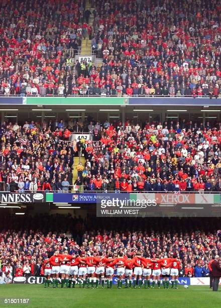General view of Welsh players on the ground as they perform the national anthem before the quarterfinal Rugby World Cup match between Wales and...