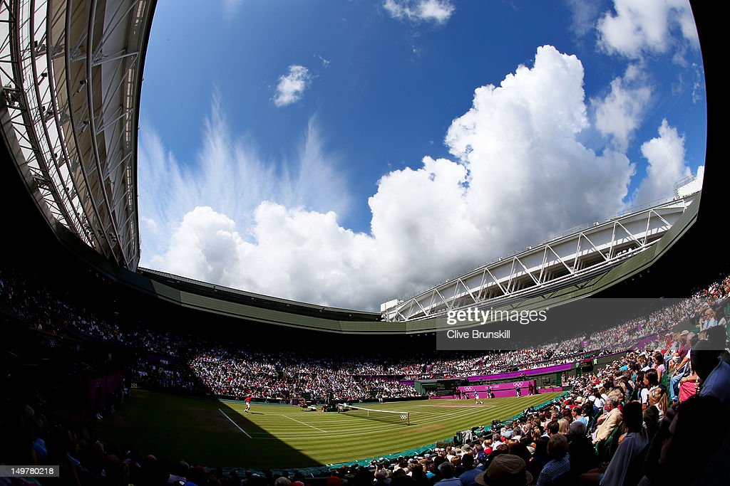 A general view of Wimbledon is seen as <a gi-track='captionPersonalityLinkClicked' href=/galleries/search?phrase=Roger+Federer&family=editorial&specificpeople=157480 ng-click='$event.stopPropagation()'>Roger Federer</a> of Switzerland returns a shot against <a gi-track='captionPersonalityLinkClicked' href=/galleries/search?phrase=Juan+Martin+Del+Potro&family=editorial&specificpeople=606583 ng-click='$event.stopPropagation()'>Juan Martin Del Potro</a> of Argentina in the Semifinal of Men's Singles Tennis on Day 7 of the London 2012 Olympic Games at Wimbledon on August 3, 2012 in London, England.