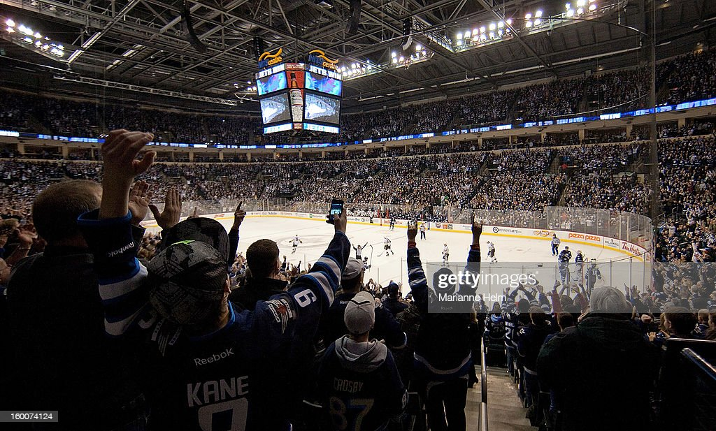 General view of Winnipeg Jets fans cheering as the clock counts down in a 4-2 win against the Pittsburgh Penguins in NHL action on January 25, 2013 at the MTS Centre in Winnipeg, Manitoba, Canada.
