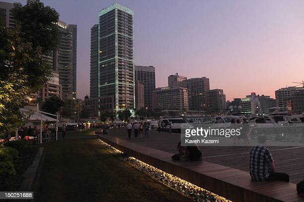 A general view of Zaitunay Bay and the new waterfront at night with people walking and the cityscape in the background on July 18 2012 in Beirut...
