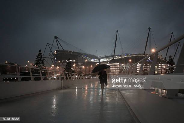 A general view outside the stadium as torrential rain falls before the UEFA Champions League match between Manchester City and VfL Borussia...
