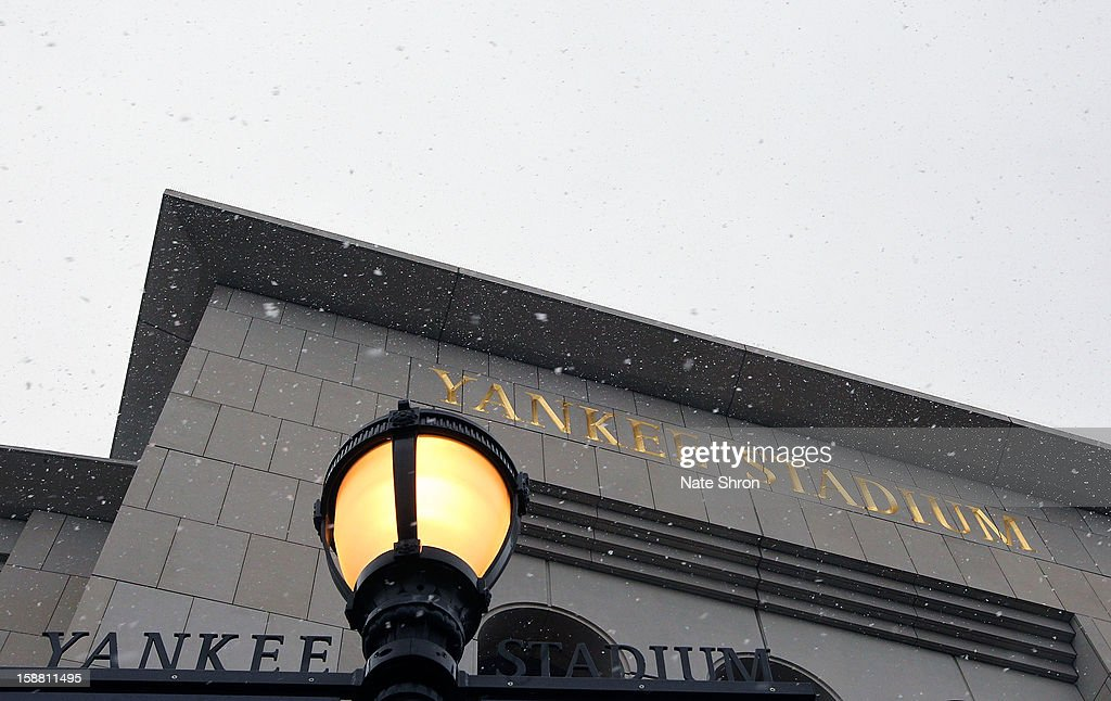 A general view outside Yankee Stadium as snow falls before the New Era Pinstripe Bowl game between the Syracuse Orange and the West Virginia Mountaineers at Yankee Stadium on December 29, 2012 in the Bronx borough of New York City.