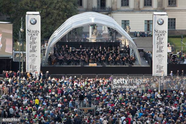 A general view scene showing Conductor Daniel Barenboim leads musicians and singers in a free openair performance of Beethoven's 9th Symphony and...