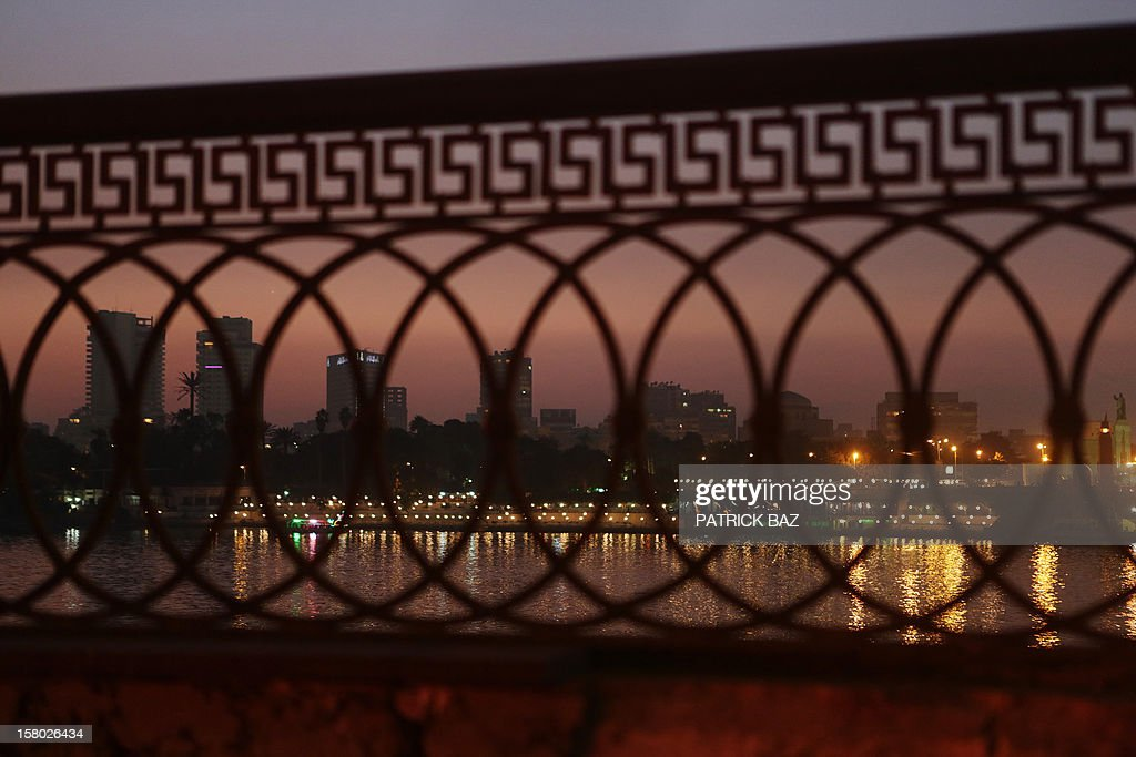 A general view, seen through a bridge barrier, shows the Cairo skyline and the Nile river on December 9, 2012. Egypt's main opposition parties were to meet to decide whether to keep up street protests against President Mohamed Morsi after the Islamist leader made a key concession in the crisis dividing the nation. AFP PHOTO/PATRICK BAZ