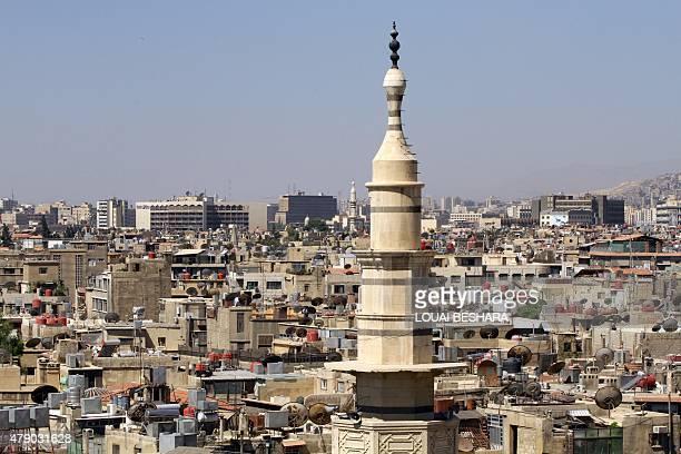 A general view shot taken on June 30 shows a neighbourhood in the Syrian capital Damascus AFP PHOTO / LOUAI BESHARA
