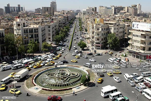 A general view shot taken on June 30 shows traffic on a roundabout in the Syrian capital Damascus AFP PHOTO / LOUAI BESHARA