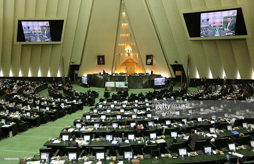 A general view show Iranian President Mahmoud Ahmadinejad delivering a speech to the parliament in Tehran on February 3, 2013. A large majority of MPs voted in a heated parliament session, broadcast on state radio, to remove the labour and social welfare minister, Abdolreza Sheikholeslam, for refusing to sack a controversial figure, Saeed Mortazavi.