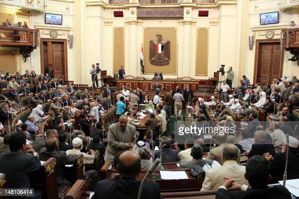 A general view show the first session of the Egyptian parliament in Cairo on July 10 after Egypt's top court rejected a decree by President Mohamed...