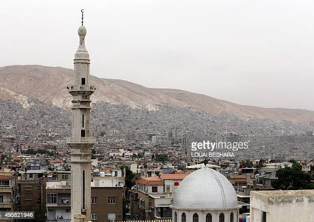 A general view show thef Abu Rummaneh neighbourhood in the Syrian capital Damascus with AlHassan mosque in the foreground and the Syrian capital's...