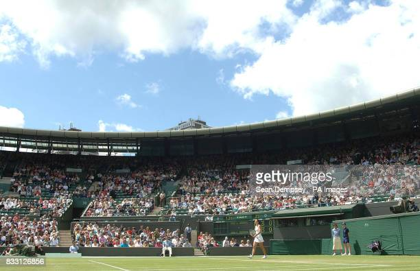A general view showing Serbia's Jelena Jankovic in action against Czech Republic's Lucie Safarova on Court One during The All England Lawn Tennis...