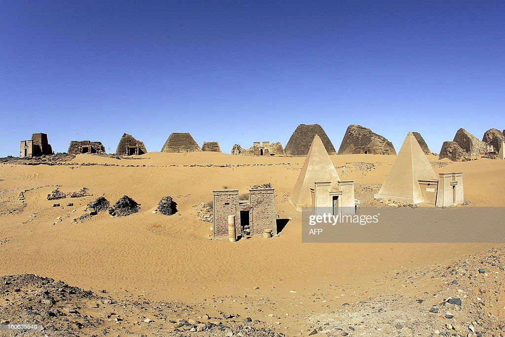 A general view shows 27 January 2006 the Meroe archaeological site, 300 kms north of the Sudanese capital Khartoum. The Meroe pyramids form one of the most spectacular sights in Sudan with about fifty small ruinous pyramids – the tombs of the rulers of Kush from about 250 BC to 350 AD. The pyramids lie on the tops of two rocky ridges blanketed by sand dunes about three miles east of the Nile. Closer to the river are the ruins of Merowe, the later capital of Kush where the remains of the royal palaces and temples may still be seen under the canopy of an acacia forest.