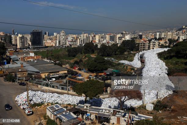 A general view shows a built up pile of waste on a street in Beirut's northern suburb of Jdeideh on February 25 2016 Lebanon canceled a plan to...