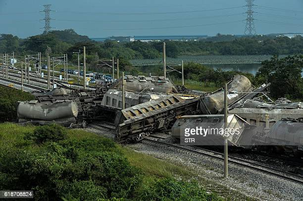 TOPSHOT A general view shows a cargo train after it derailed along a heavily travelled northsouth rail corridor in the northern state of Perak on...