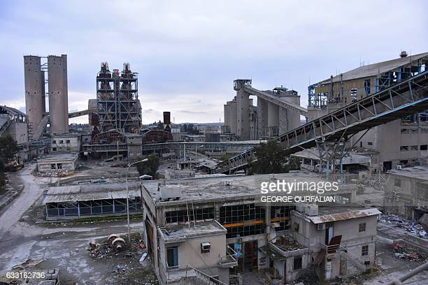 A general view shows a cement factory Aleppo's Sheikh Saeed district on January 31 2017 as engineering specialists tour the factory to analyse how to...