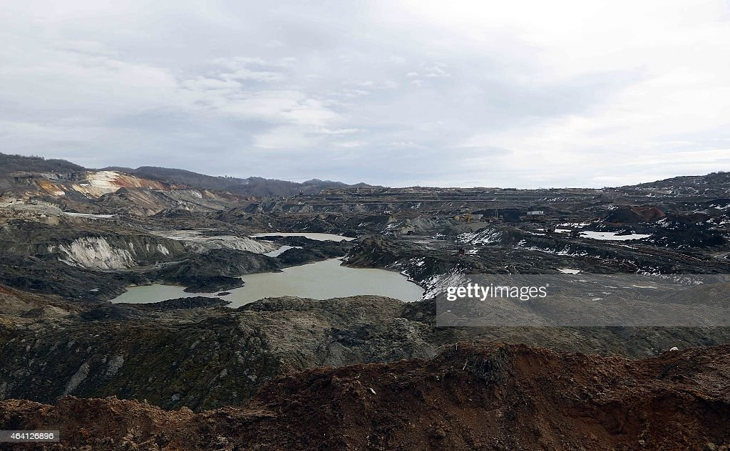 A general view shows a coal mine and slag heaps located close to the Bosnian village of Dubrave near the northeastern town of Tuzla on February 22...