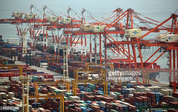 General view shows a container wharf in Tokyo port on April 22 2015 Japan posted its first trade surplus in almost three years as exports to North...
