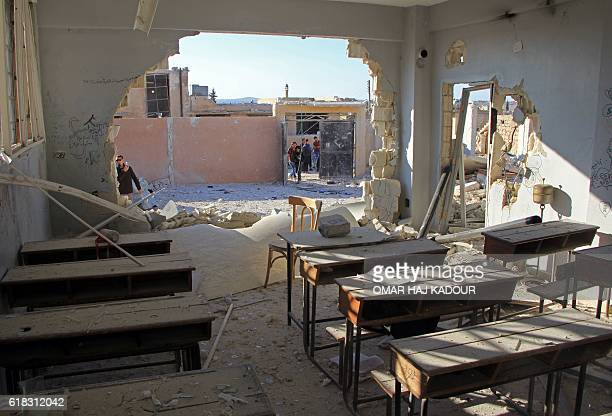TOPSHOT A general view shows a damaged classroom at a school after it was hit in an air strike in the village of Hass in the south of Syria's...