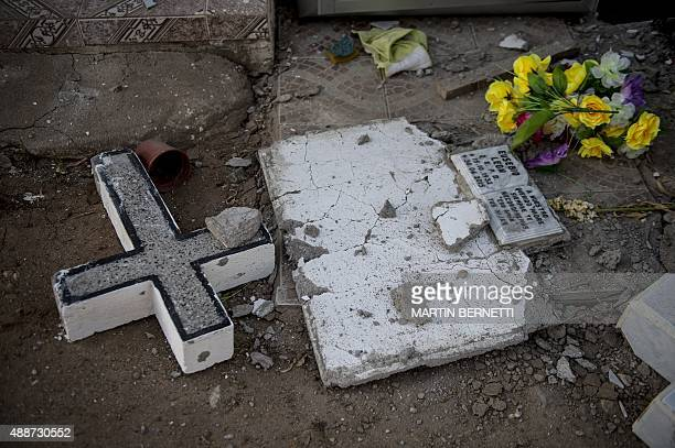 A general view shows a damaged headstone at a cemetery after an earthquake in Illapel some 200 km north of Santiago on September 17 2015 A powerful...