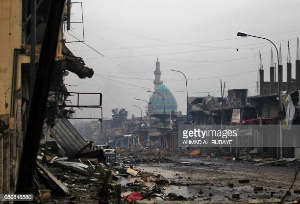 TOPSHOT A general view shows a destroyed street as the Iraqi counterterrorism service advance towards the Yabasat neighbourhood on March 23 2017...