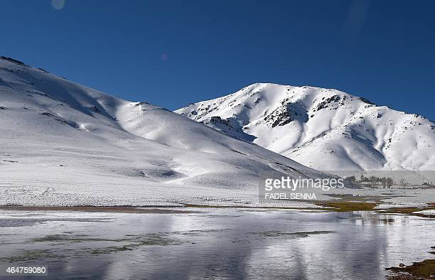 A general view shows a frozen lake the Oukaimeden ski resort in the Atlas Mountains 30 kilometres from the popular tourist resort of Marrakesh on...