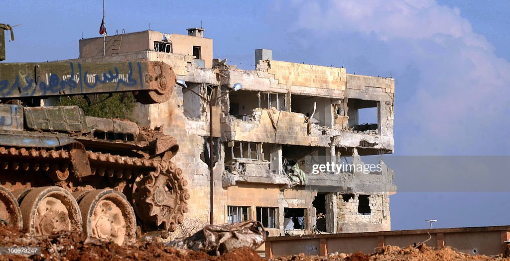 A general view shows a heavily damaged building in the al-Layramun district of the northern city of Aleppo, which is under government troops control, on November 26, 2012. Syrian rebels aiming to encircle Aleppo virtually cut off roads to the city from neighbouring Raqqa province as the army targeted rebel strongholds around Damascus.