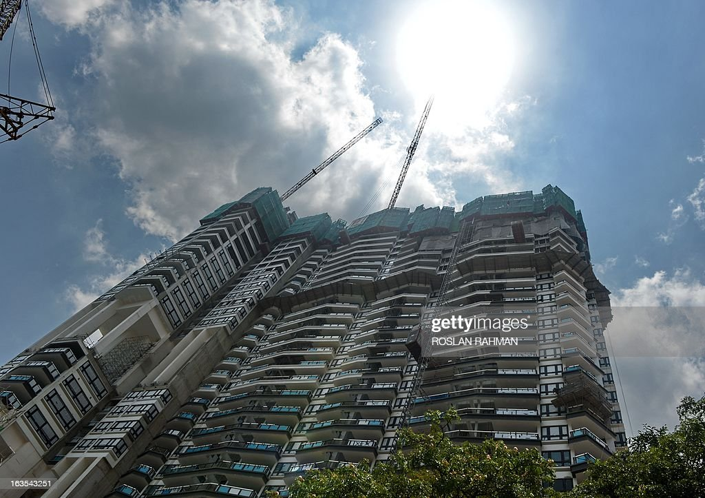 A general view shows a new private condominium under construction near the business district in Singapore on March 12, 2013. Growth in Singapore's trade-reliant economy slowed down sharply in 2012, expanding 1.3 percent as exports tumbled due to a global economic slump, official data showed February 22.