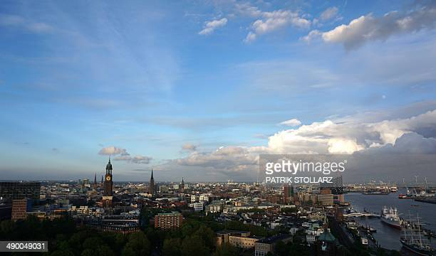 A general view shows a part of Hamburg's city and the Elbphilharmonie Philharmonic Hall next to the river Elbe in Hamburg northern Germany on May 12...