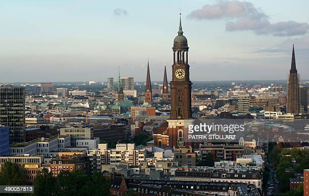 A general view shows a part of Hamburg's city and the 'Hamburger Michel' church in Hamburg northern Germany on May 12 2014 AFP PHOTO / PATRIK STOLLARZ