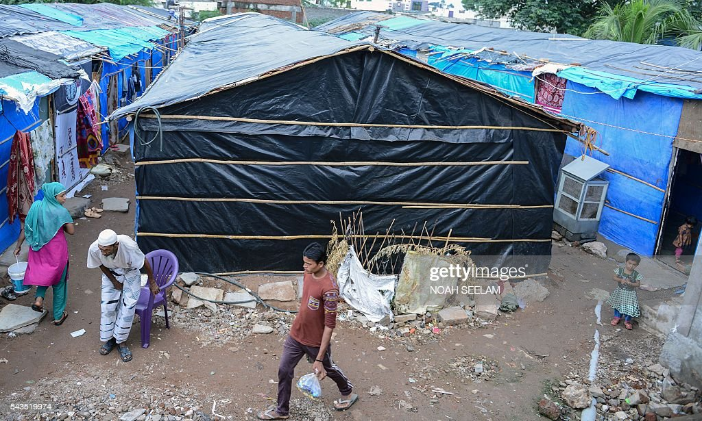 A general view shows a refugee camp set up by Rohingya Muslims in the old city of Hyderabad on June 29, 2016. More than 1,200 Rohingya Muslims fleeing sectarian violence in Myanmar have settled in crammed quarters and makeshift shelters in the old city in Hyderabad, in the southern Indian state of Telangana. The Rohingyas have been described by the United Nations as one of the world's most persecuted minorities. They have fled Myanmar in their thousands in recent years as hardline monks and Buddhist nationalists fiercely oppose moves to recognise them as an official minority and insist on calling them 'Bengalis' -- shorthand for illegal migrants from the border with Bangladesh. / AFP / NOAH
