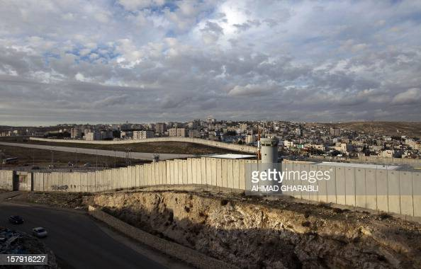 A general view shows a section of Israel's controversial separation barrier in the West Bank village of AlRam on the outskirts of Jerusalem on...