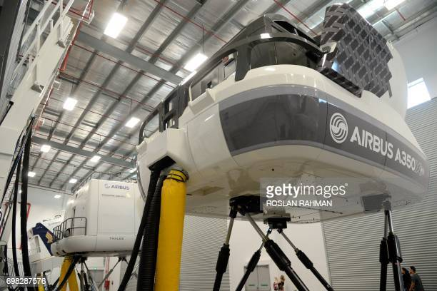 A general view shows a simulator of the A350 XWB during a media tour of the Airbus Asia Training Centre in Singapore on June 20 2017 Airbus Asia...