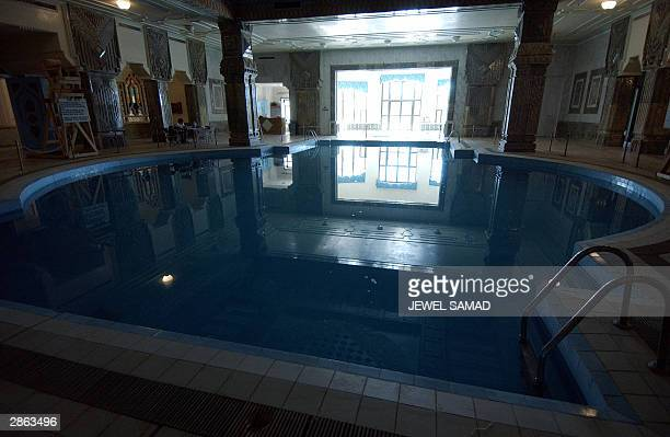 General view shows a swimming pool at one of the palaces of former Iraqi dictator Saddam Hussein which is turned into the recreation center of the...